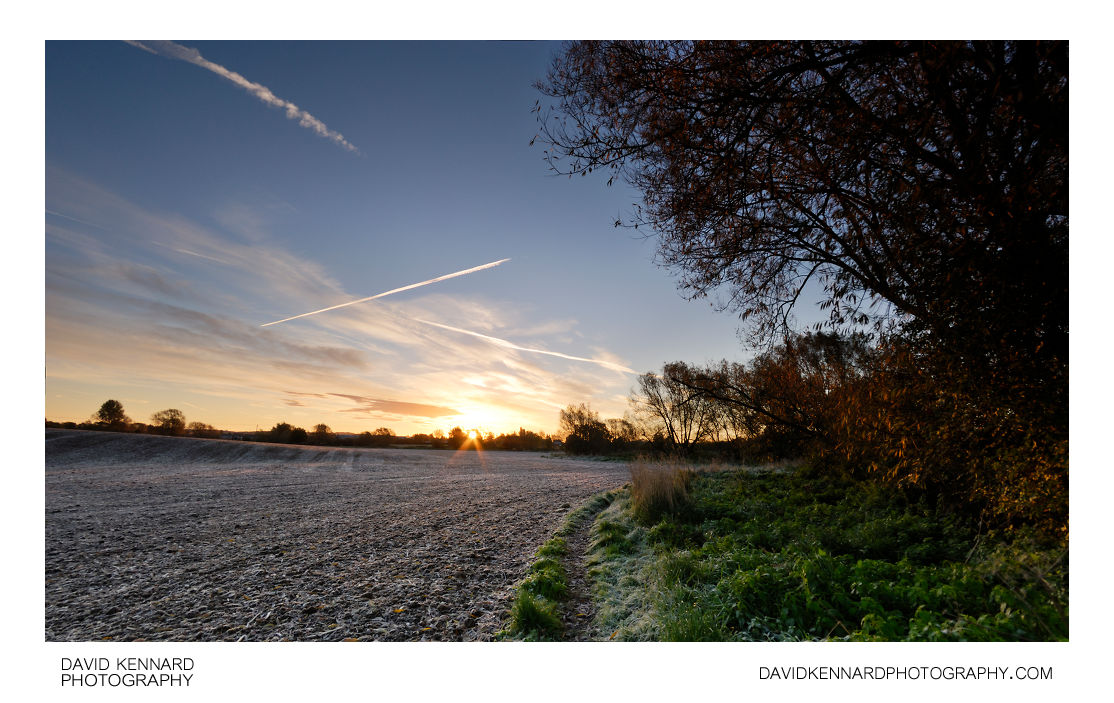 Frosty ploughed field at sunrise