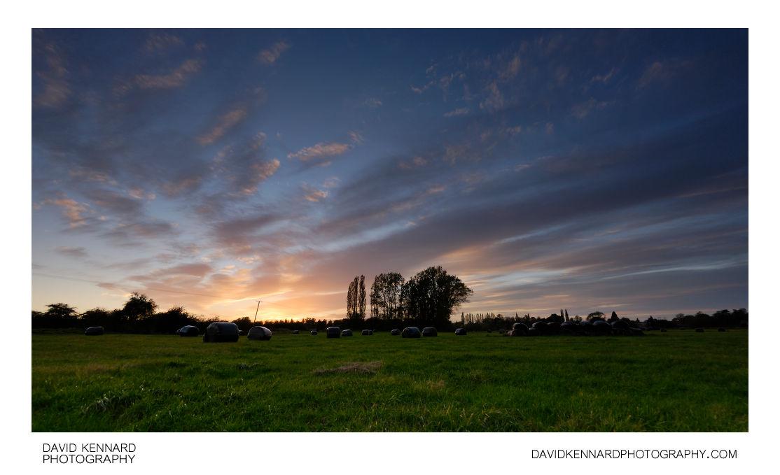 Sunset over hay field between Lubenham and Harborough