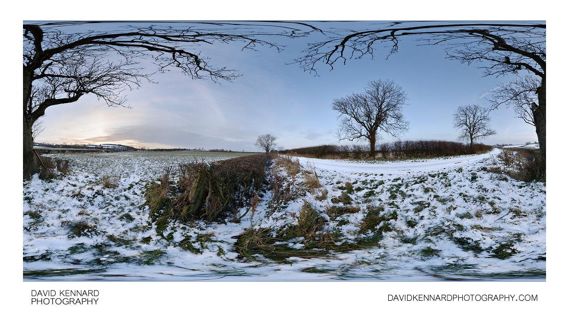 Snowy field near East Farndon at twilight