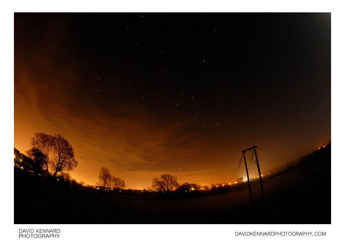 Orange clouds in the night sky