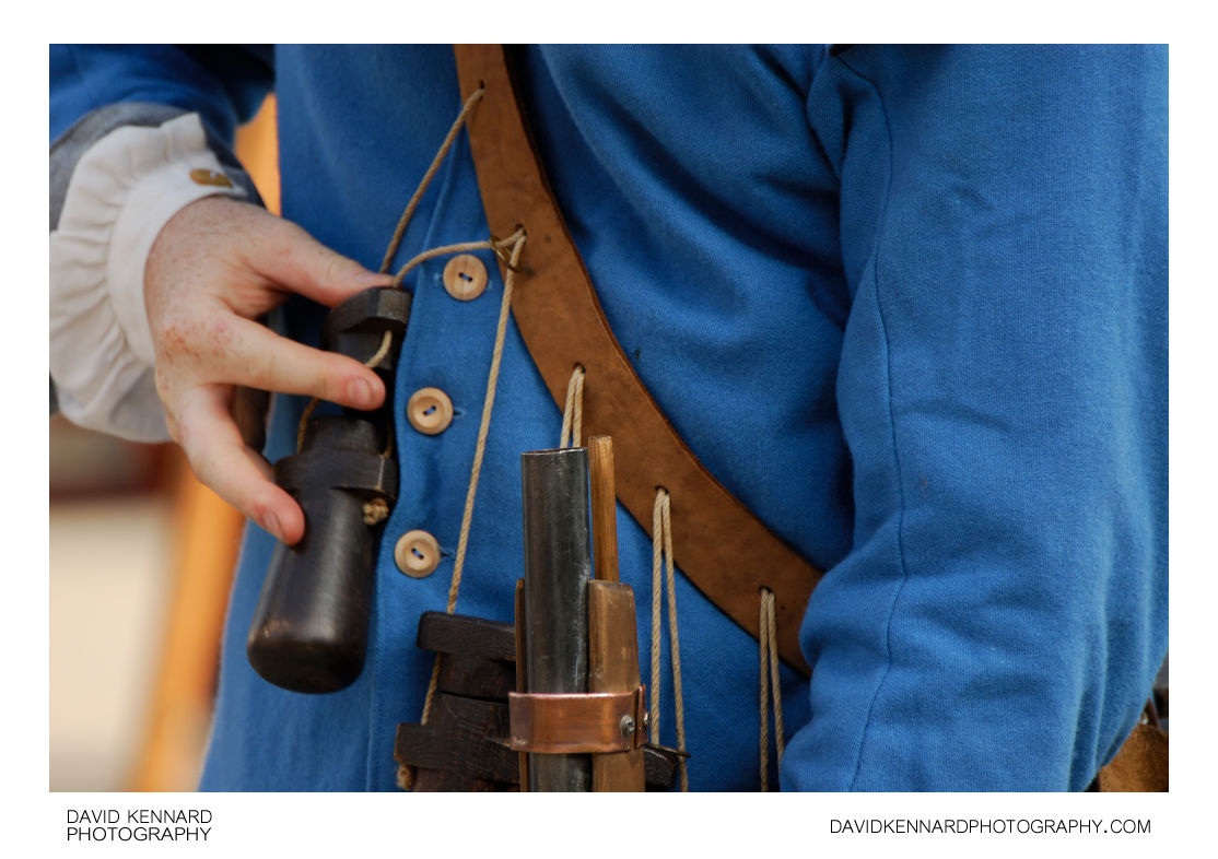 A Royalist Musketeer loads his Musket