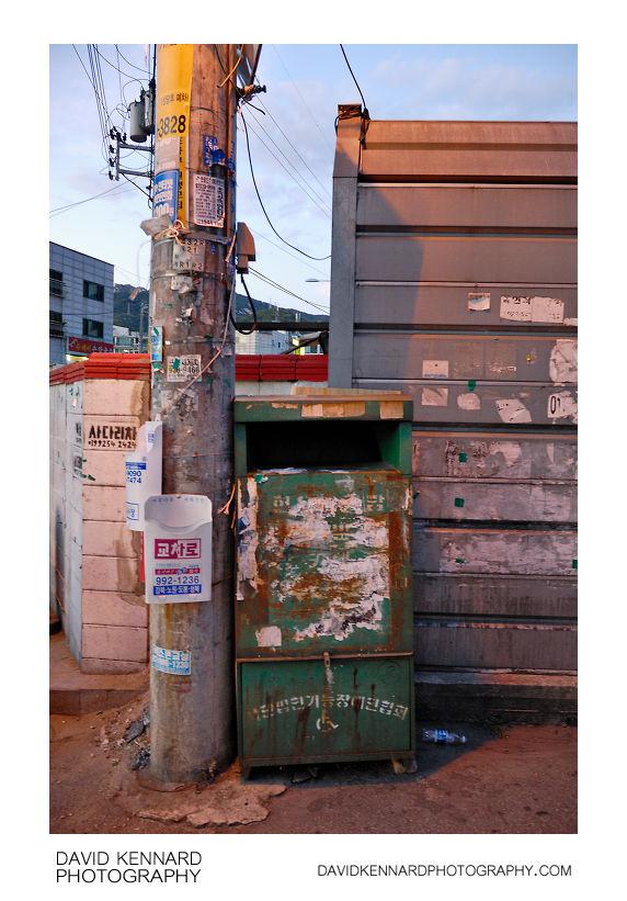 Stickered bin and pole