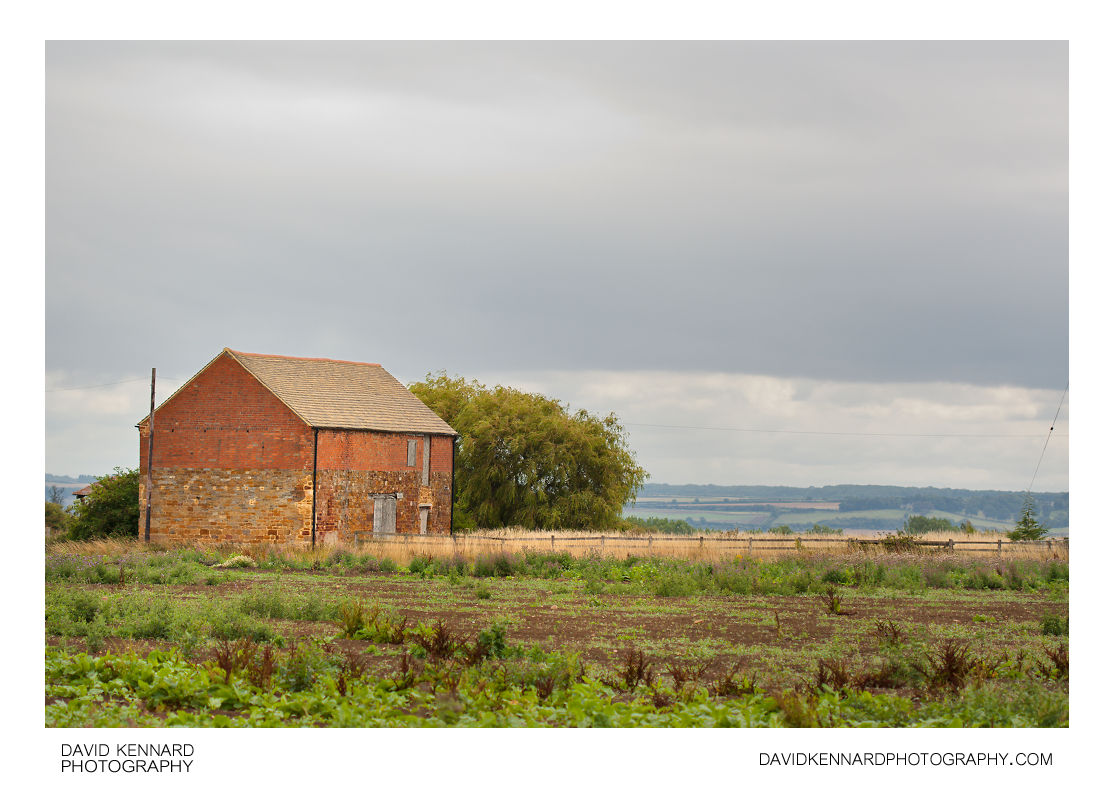 Ironstone and red brick farm building