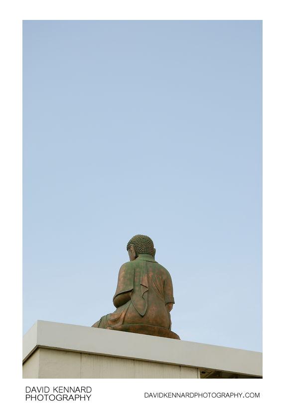 Buddha sits on building