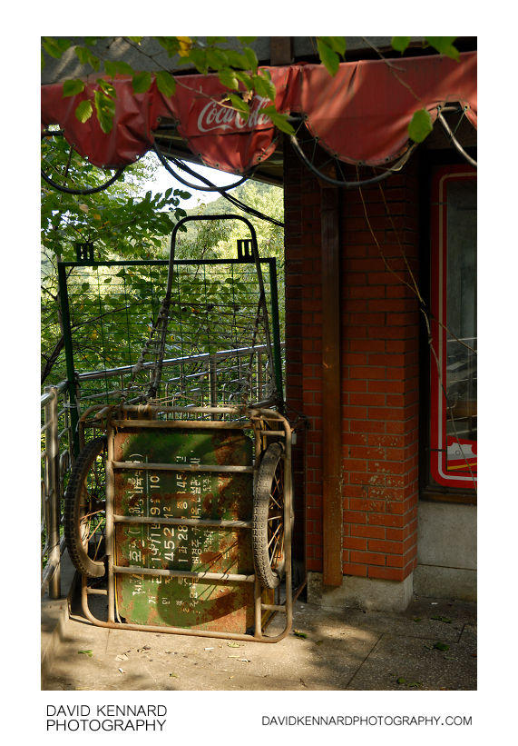 Old cart by vacant cafe