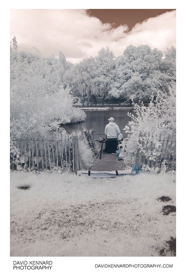Infrared photo of a fisherman at Corby Boating Lake