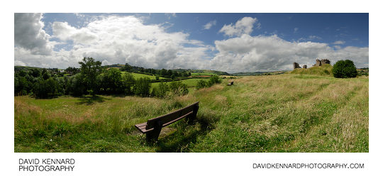 Bench and grass by Clun Castle