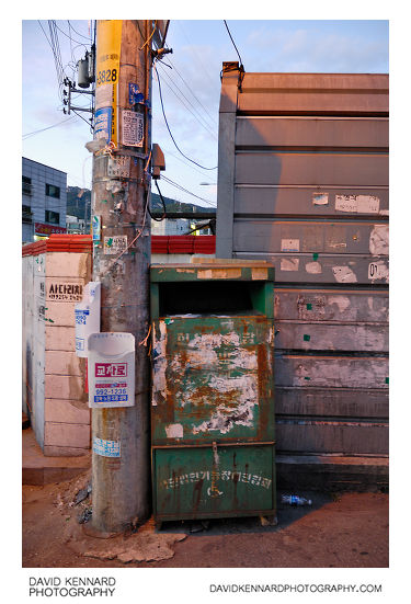 Stickered bin and pole