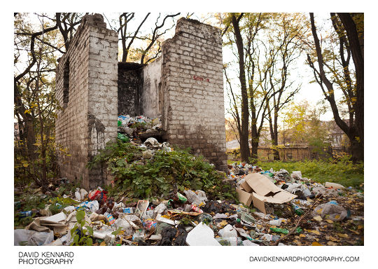 Rubbish appears to spill out of a small abandoned building in a park by Metallurgists' Square in Dnipropetrovsk, Ukraine.