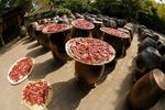 Drying peppers on earthenware jars
