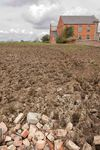 Muddy field and Baptist Chapel, Clipston