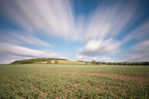 Long exposure photo of clouds above a small hill, taken with Zomei 6 stop and XCSource 10 stop ND filters
