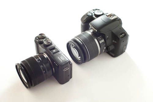 Fuji X-A1 Mirrorless Camera with Fuji 16-50mm f/3.5-5.6 zoom lens compared in size to Canon Rebel DSLR with 18-50mm f/3.5-5.6 zoom lens