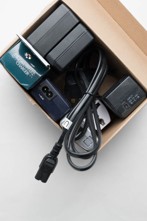 Box of battery chargers with figure 8 (IEC C7) power cable