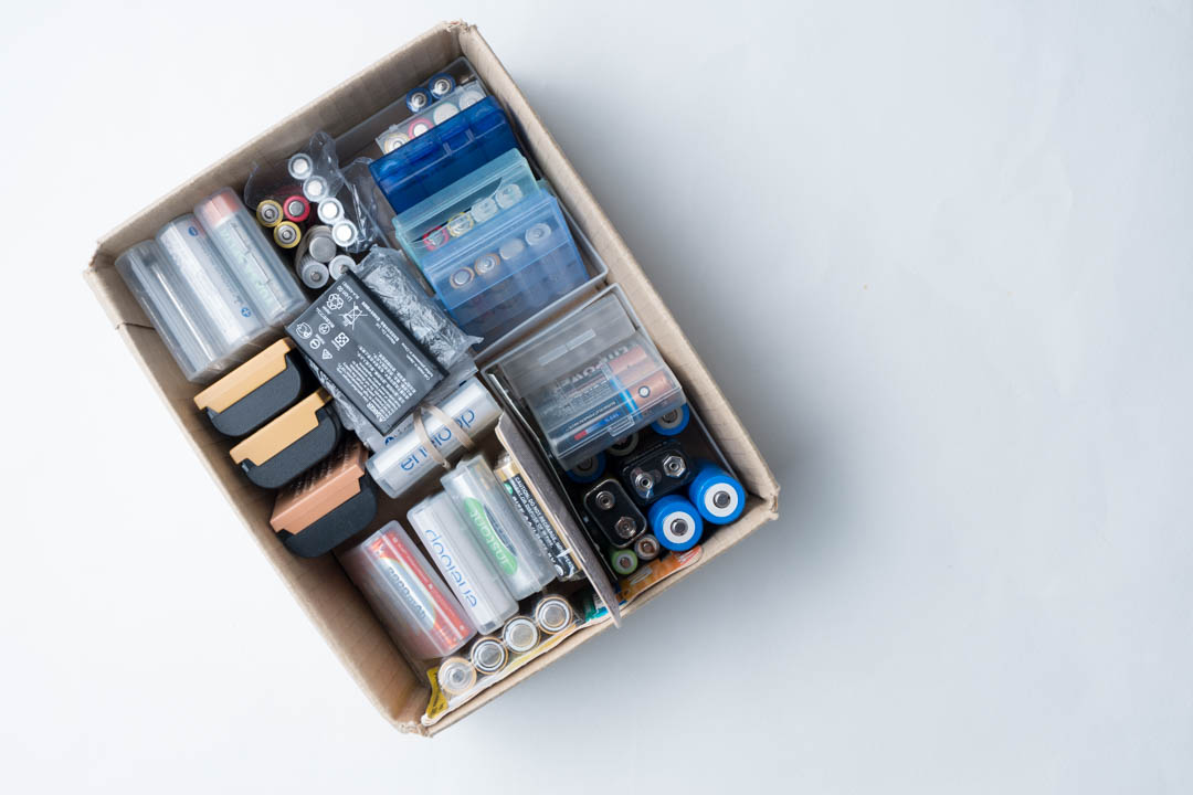 box of batteries organised into groups based on size and set size (batteries used together as a single set)