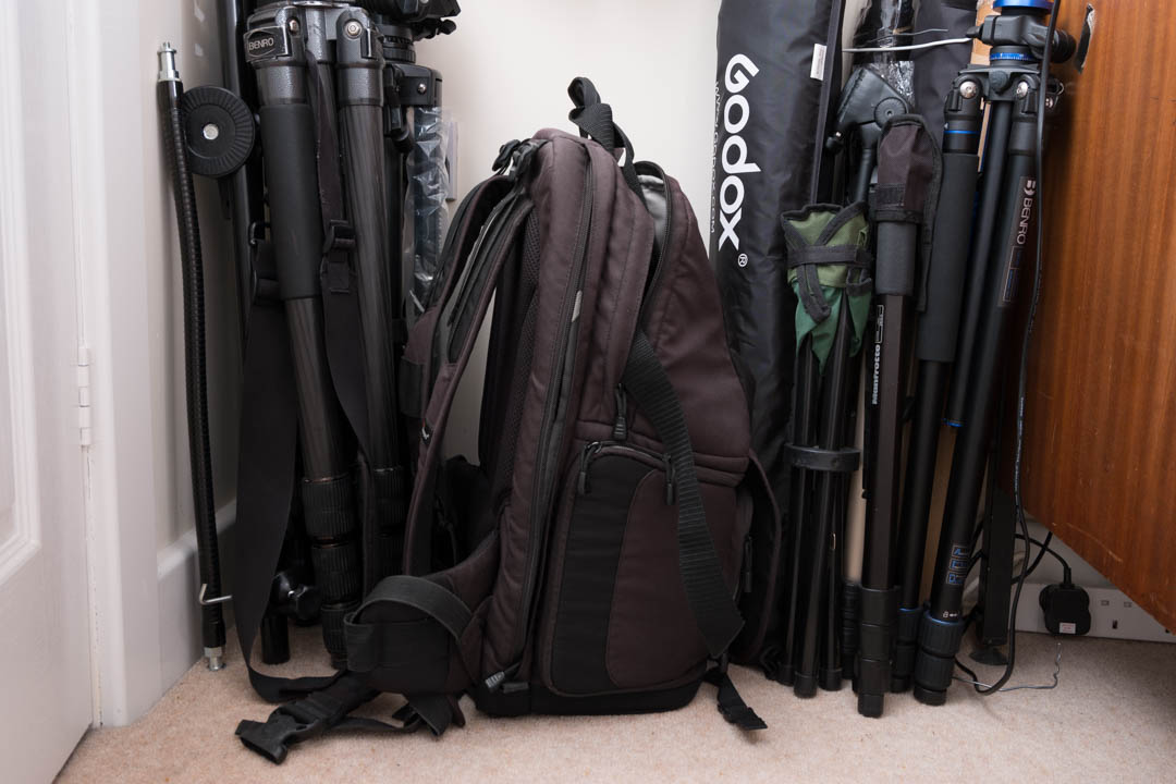 Tripods, camera bag, light modifiers etc. stored by resting them up against wall