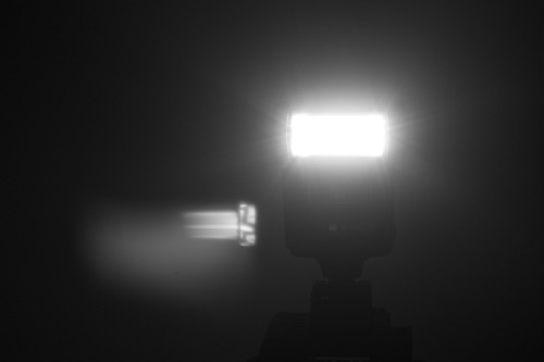 Image of a flash pointed at camera to create lens flare, taken with 75mm EL-Nikkor on full spectrum Fuji X-M1 and with B+W 486 UVIR cut filter on the lens.