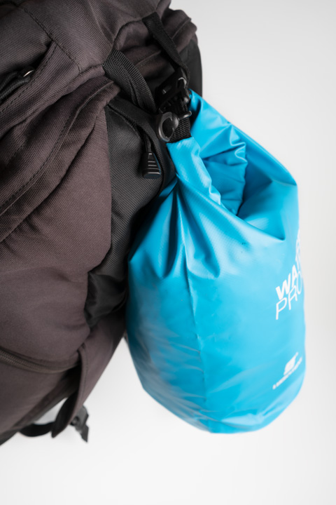 Extra bag attached to top handle to provide extra carrying capacity