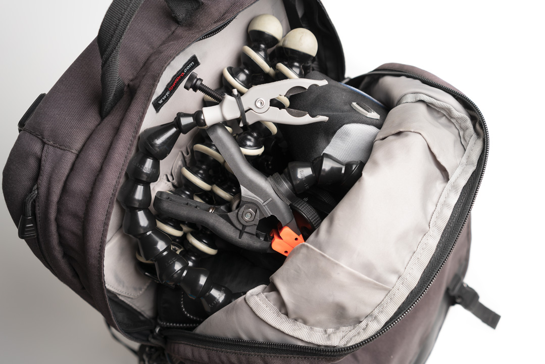 Top section of the bag loaded with photography accessories