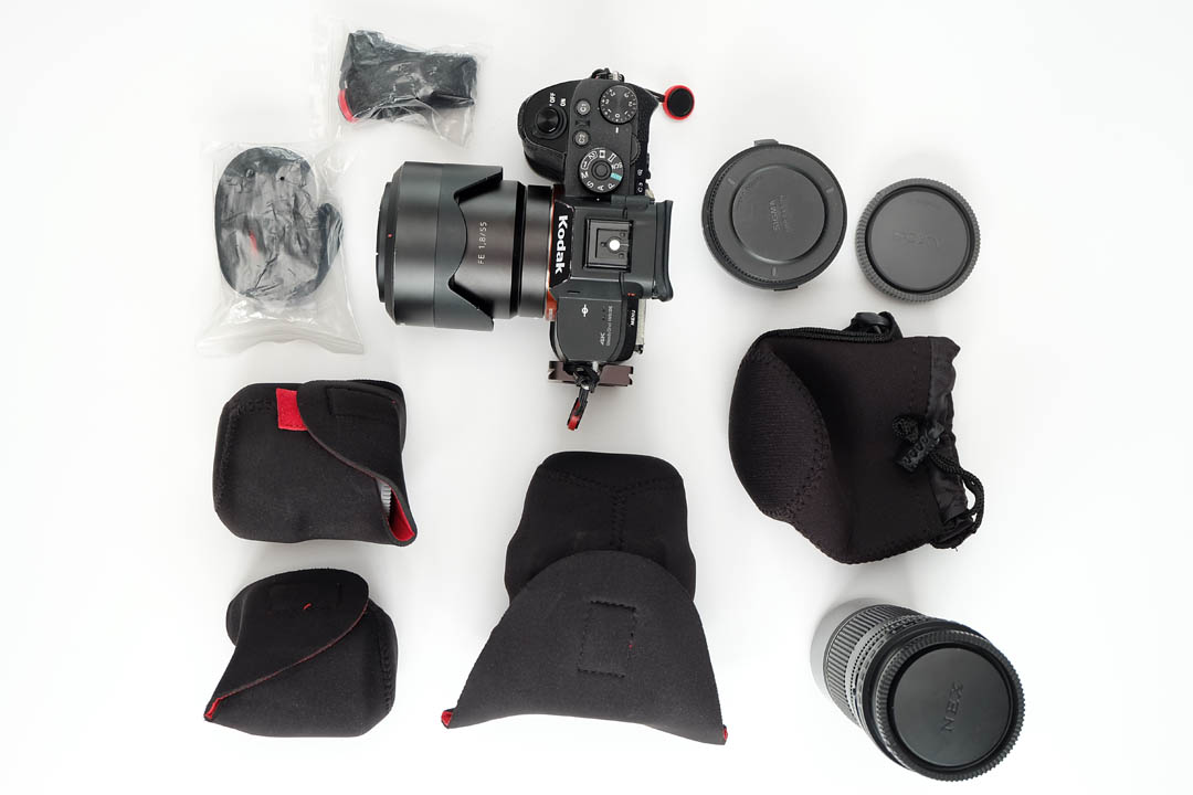 Camera, straps, lenses, and adapter