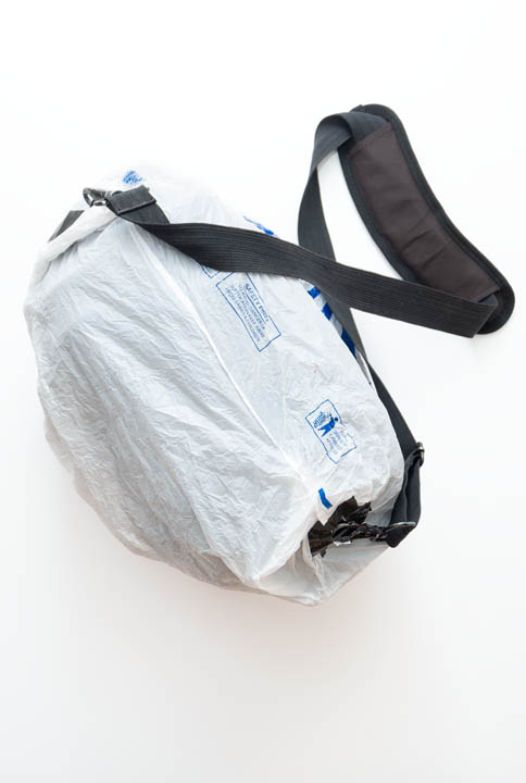 Camera bag covered with plastic bag rain cover