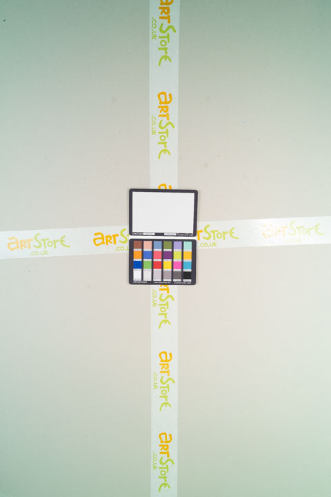 Photo of sheet of grey card taken on a standard camera with a wide-angle lens with B+W 486 filter