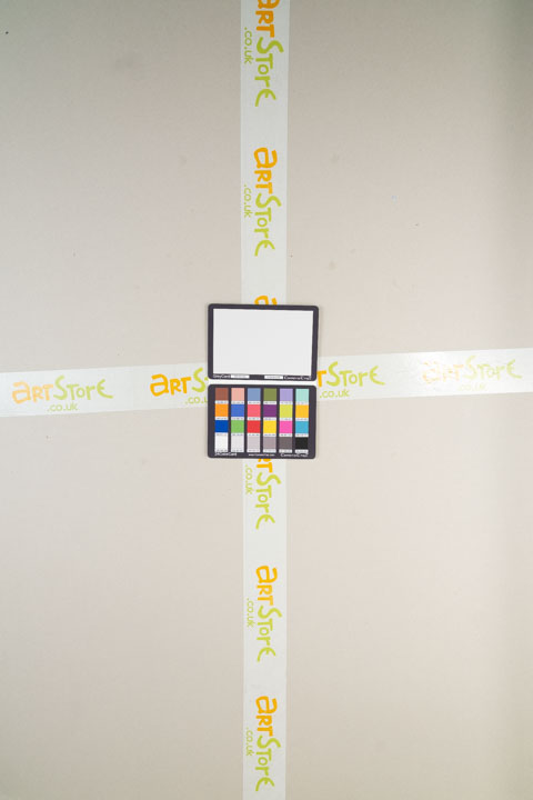 Photo of sheet of grey card taken on a standard camera with a wide-angle lens with Tiffen Hot Mirror filter