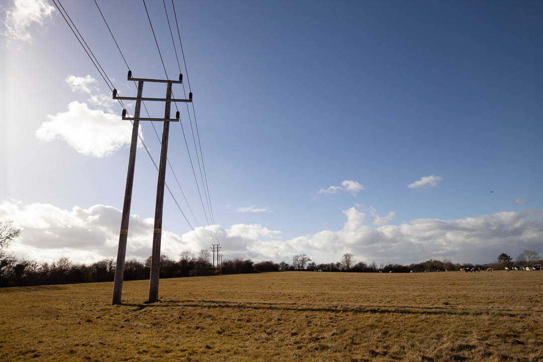 Photo of power lines crossing a field taken on a standard Canon 5D Mark II camera with a wide-angle lens with Schott BG40 filter