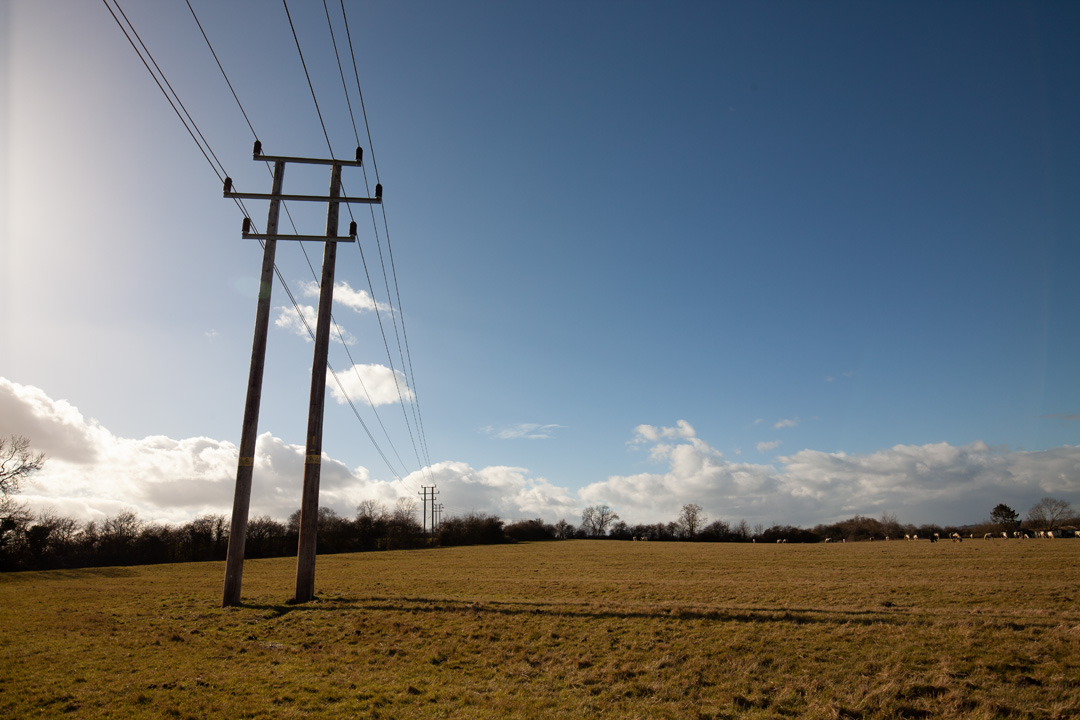 Photo of power lines crossing a field taken on a standard Canon 5D Mark II camera with a wide-angle lens with SLR Magic Image Enhancer Pro filter