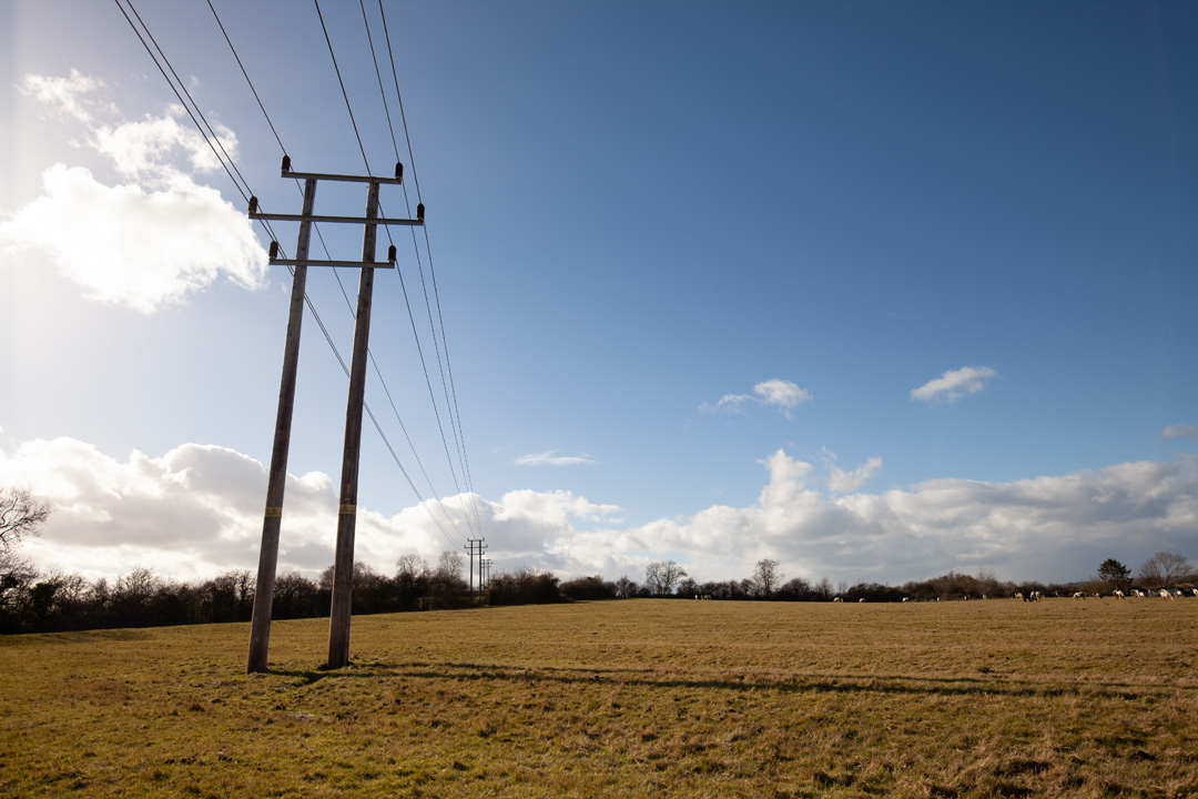 Photo of power lines crossing a field taken on a standard Canon 5D Mark II camera with a wide-angle lens with no filter