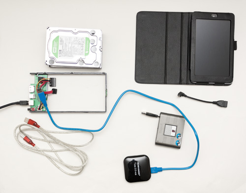 Google Nexus 7 tablet with hard drives, USB to SATA drive enclosure, USB hub, card reader, and USB OTG cable