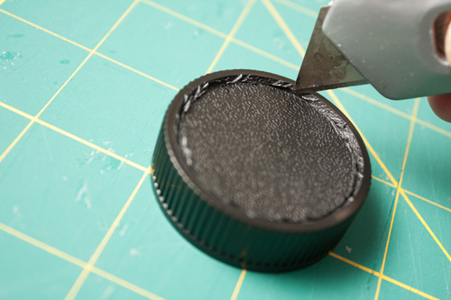 Cutting out the centre of the rear lens cap using a craft knife