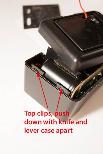Clips at top of Sunpak Auto 170 flash, which hold the two halves together