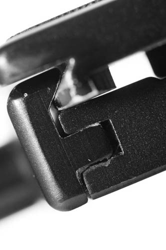 Edge of quick release clamp tightened on a standard arca-swiss compatible quick release plate - the clamp grips the plate securely