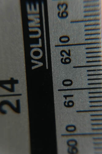 Photo of a ruler taken with Fuji X-A1 and 16-50mm kit lens at 50mm and minimum focus distance and Sonia +10, +4, +2, and +1 close-up filters attached