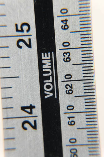 Photo of a ruler taken with Fuji X-A1 and 16-50mm kit lens at 50mm and minimum focus distance and Sonia +10 close-up filter attached