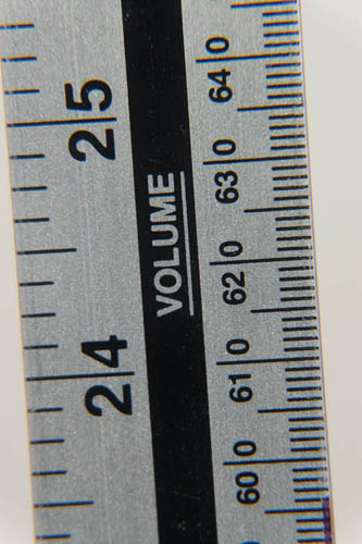 Photo of a ruler taken with Fuji X-A1 and 16-50mm kit lens at 50mm and minimum focus distance and Sonia +4, +2, and +1 close-up filters attached