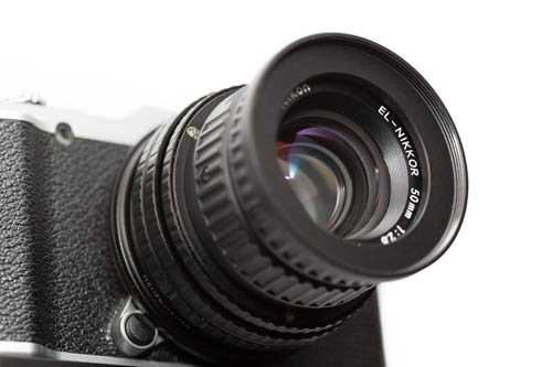 Fujifilm X-M1 camera with DIY Fuji X to M42 mount short adapter, 17-31mm M42 focusing helical, and EL-Nikkor 50mm f/2.8 N lens