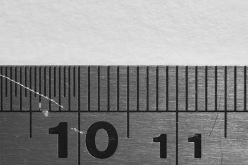 Photo of a ruler showing magnification of Pixco Fuji X to M42 mount adapter with helical fully expanded, plus 17-31mm helical at 31mm with EL-Nikkor 50mm f/2.8 enlarging lens