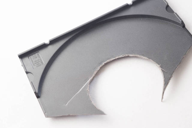 CD case with section cut out for use in making DIY Lensbaby M39 mount adapter