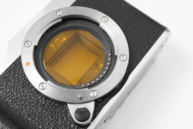 Fuji X-M1 camera with deep yellow internal filter attached