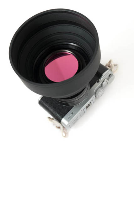 Adapter in use with rubber lens hood and filter both attached